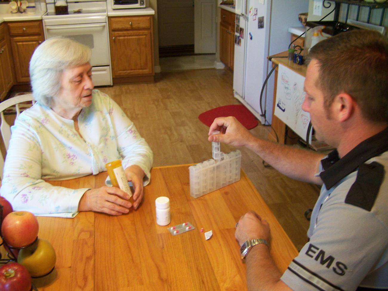 Community member receiving information from a paramedic