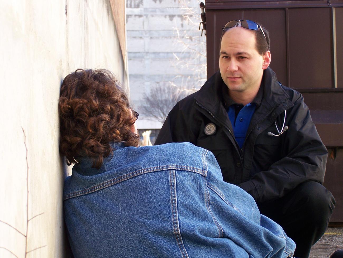 Paramedic comforts a community member in distress