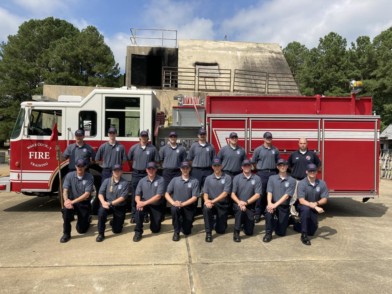 Wake County Fire Academy 13 recruits post in front of a fire truck