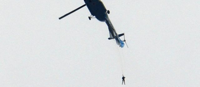 Russian soldier dangles from helicopter after parachute gets caught after jumping at 6,500 feet