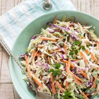Photo of cabbage, carrot, and herb salad in a bowl