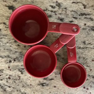 three red dry measuring cups
