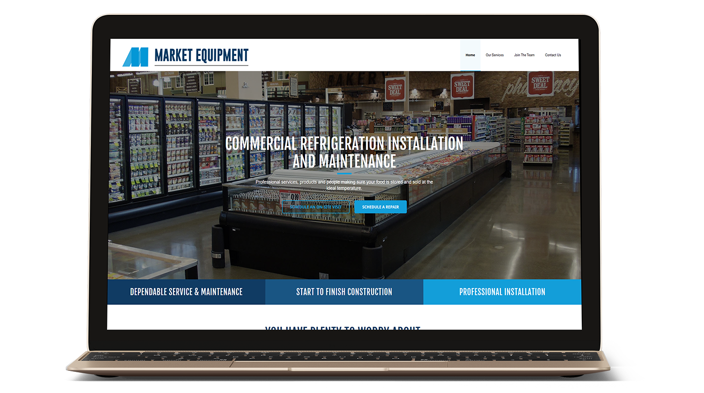 Market Equipment's website on a laptop