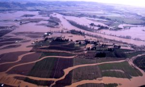 Aerial shot of riber channel and flooded farmland.