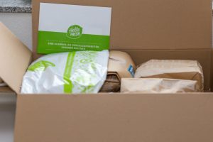 A cardboard box containing a meal kit.