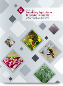 Cover of 2020 annual report; gray with scattered image diamonds featuring agricultural scenes